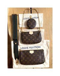 Sac en bandoulière en tissu toile Multi-pochette accessoires beige Louis Vuitton en coloris Natural