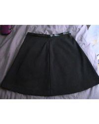 Jupe mi-longue polyester noir Sandro en coloris Black