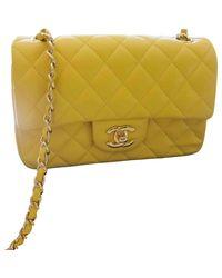 Sac en bandoulière en cuir cuir Timeless jaune Chanel en coloris Multicolor