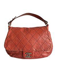 Sac à main en cuir cuir rouge Chanel en coloris Red