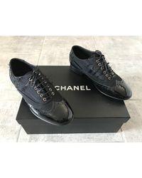 Chaussures à lacets tissu noir Chanel en coloris Black