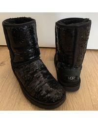 Bottines & low boots plates a paillettes noir Ugg en coloris Black