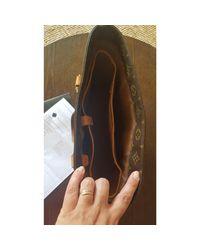 Sac à main en cuir cuir marron Louis Vuitton en coloris Brown