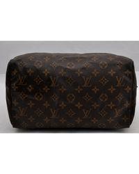 Sac à main en cuir cuir Speedy marron Louis Vuitton en coloris Brown