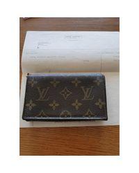 Porte-monnaie cuir marron Louis Vuitton en coloris Brown