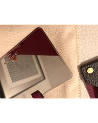 Trousse cuir marron Louis Vuitton en coloris Brown
