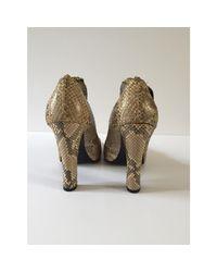 Escarpins python beige Givenchy en coloris Natural
