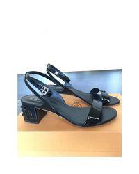 Sandales à talons cuir verni noir Tod's en coloris Black