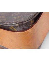 Sac en bandoulière en tissu toile marron Louis Vuitton en coloris Brown