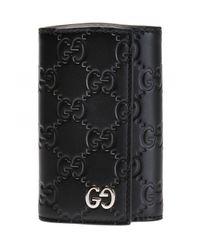 Gucci Black Logo-embossed Key Holder for men