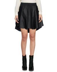 Mini-jupe Jijil en coloris Black