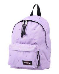Sacs à dos et bananes Eastpak en coloris Purple