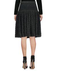 Alaïa - Black Knee Length Skirt - Lyst