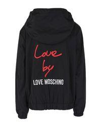 Blouson Love Moschino en coloris Black