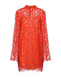 Robe courte Stella McCartney en coloris Orange