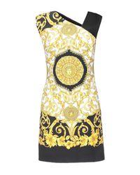 Robe courte Versace en coloris White