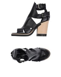 Strategia - Black Sandals - Lyst