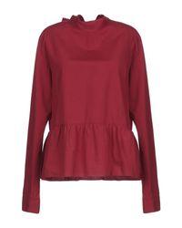 Blusa di Caliban in Red