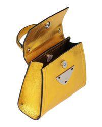 Borsa a mano di Coccinelle in Yellow