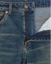 Jean skinny en denim usé dirty sandy blue Saint Laurent