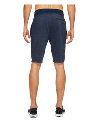 Under Armour Blue Sportstyle Terry Tapered Shorts for men