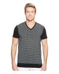 Calvin Klein | Black Solid Dot Print Graphic T-shirt for Men | Lyst