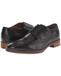 Johnston & Murphy Black Conard Wingtip for men