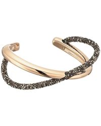 Swarovski | Brown Crystaldust Cross Cuff Bracelet | Lyst