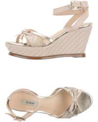 Guess Sandals beige - Lyst