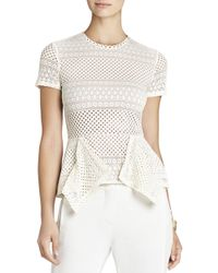 BCBGMAXAZRIA Vicktoria Mixed-Knit Peplum Top - Lyst