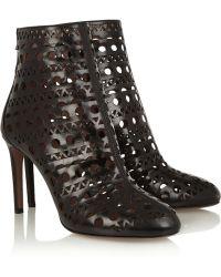 Alaïa Laser-Cut Leather Ankle Boots black - Lyst
