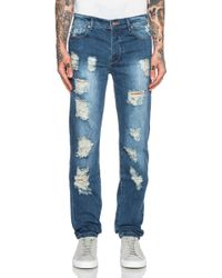 Stampd Distressed Skinny Jeans blue - Lyst