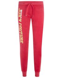 Juicy Couture Foil Print Tapered Track Pant - Lyst
