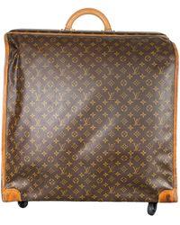 Louis Vuitton Vintage Large Folding Garment Monogram Luggage, Circa 1970. - Brown