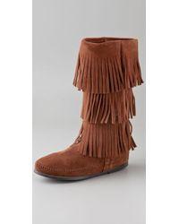 Minnetonka 3 Layer Fringe Boots - Lyst