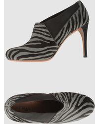 Alaïa Brown Shoe Boots - Lyst