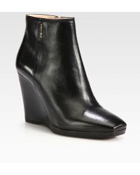 Prada Leather Wedge Ankle Boots - Black