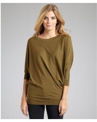 Alexander McQueen Olive Wool Asymmetric Hem Dolman Sweater green - Lyst