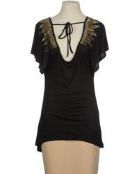 Guess Tops - Lyst