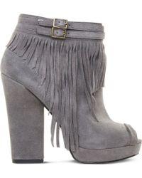 Nine West Icelandic Fringe Ankle Boots - Lyst