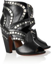 Alaïa Studded Leather Ankle Boots - Lyst