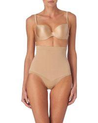 Spanx Slim Cognito Bodysuit - Lyst
