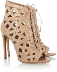 Alaïa Studded Cutout Leather Sandals - Lyst
