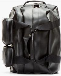 0e3aec71d9c9 Kris Van Assche - Black Pvc Convertible Duffle Backpack - Lyst