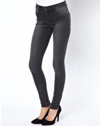 Asos Whitby Low Rise Skinny Jeans In Washed Black - Lyst