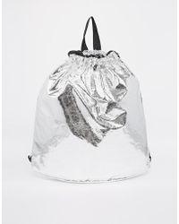Monki - Sally Cracked Silver Drawstring Backpack - Lyst