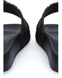 Versace Pantoletten Palazzo aus Gummi - Schwarz