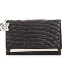 BCBGMAXAZRIA Demi Quilted Leather Tech Wallet - Lyst