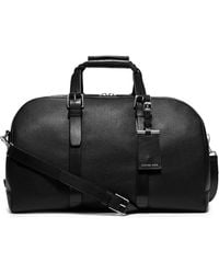 Michael Kors Textured Leather Duffle - Lyst