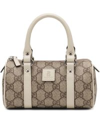Gucci  Leather-trim Gg Plus Duffle Bag - Lyst